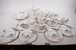 A Japanese Kutani six piece tea service with empress head lithophanes to the cups, comprising