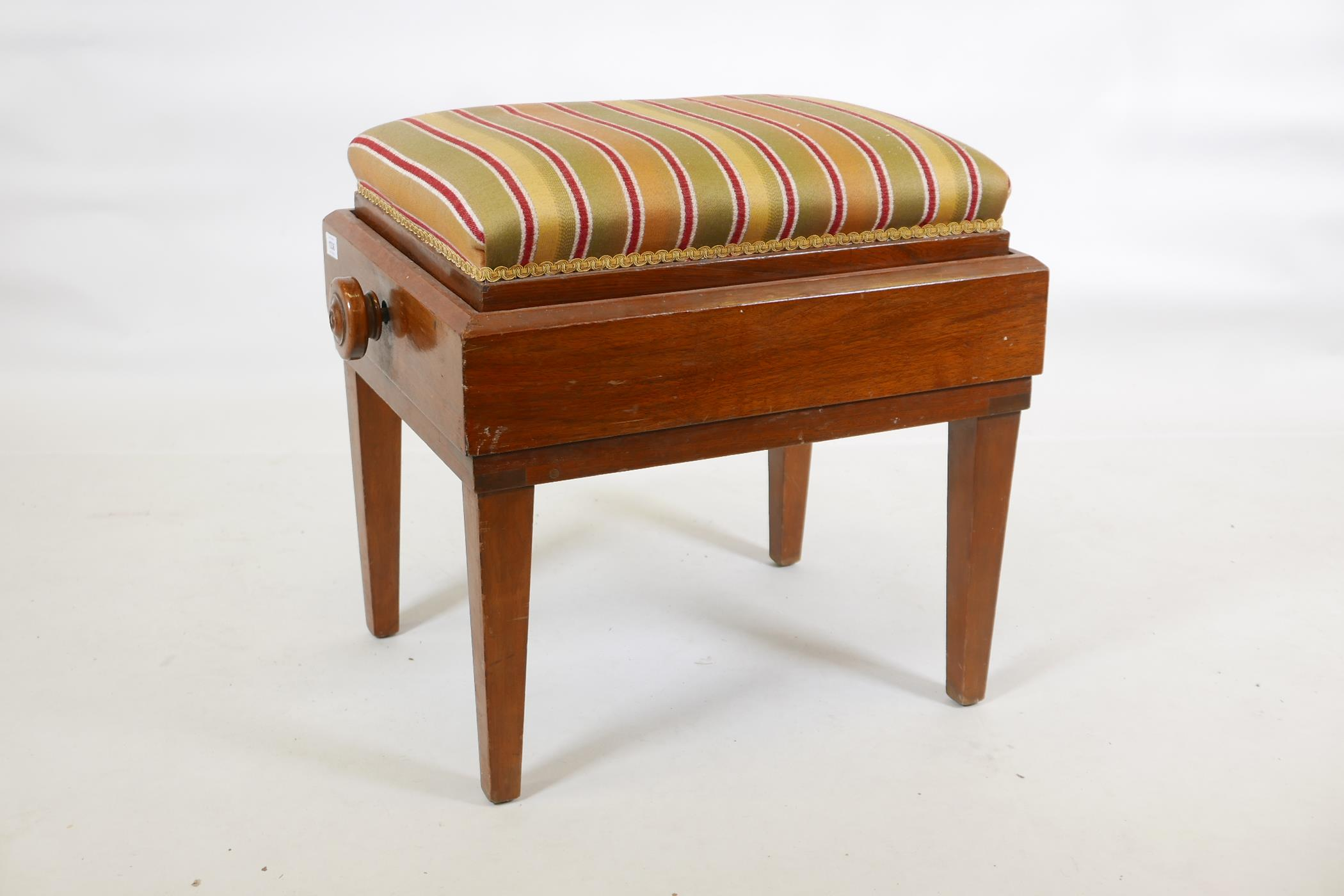 """A mahogany piano stool, with wind up scissor action height adjustment, 17"""" x 22"""" X 23"""""""