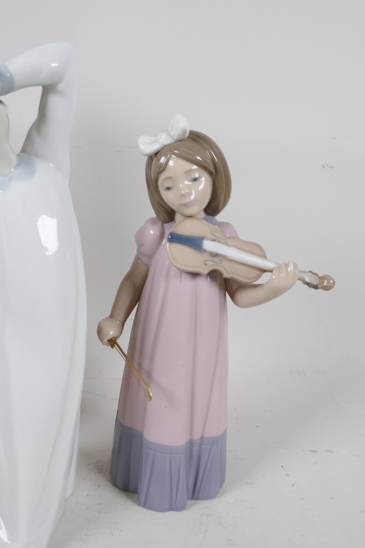 Two Lladro figures, sleepy boy and woman with geese (missing finger), a Nao Daisia figure of a - Image 4 of 5