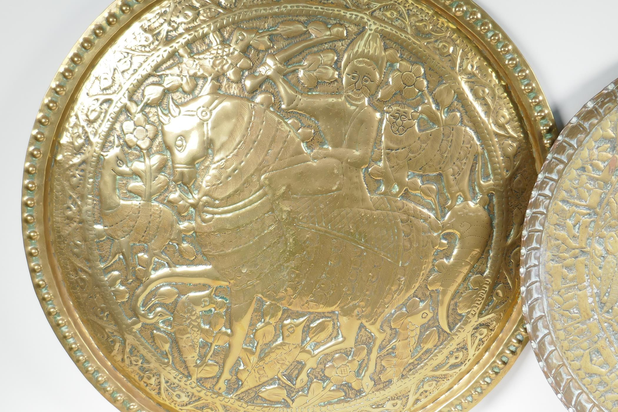 """A Persian brass charger embossed with a figure on horseback surrounded by animals and birds, 24"""" - Image 2 of 4"""