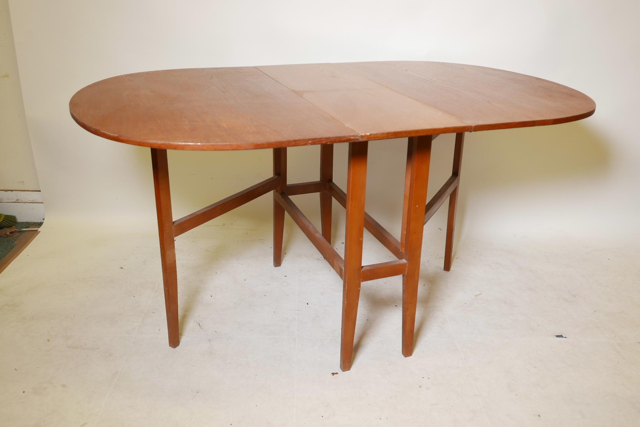 "A 1970s teak gateleg table, 59"" x 35½"", 29"" high extended - Image 2 of 3"