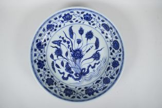 A Chinese Ming style blue and white porcelain dish with scrolling lotus flower decoration, 6