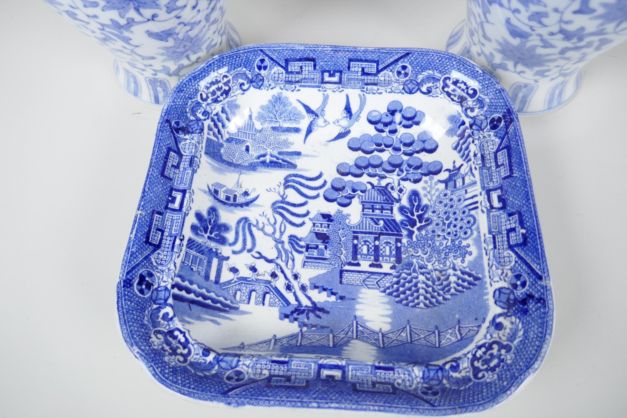 """A pair of Chinese blue and white vases decorated with stylised flowers, 12"""" high, together with a - Image 2 of 3"""