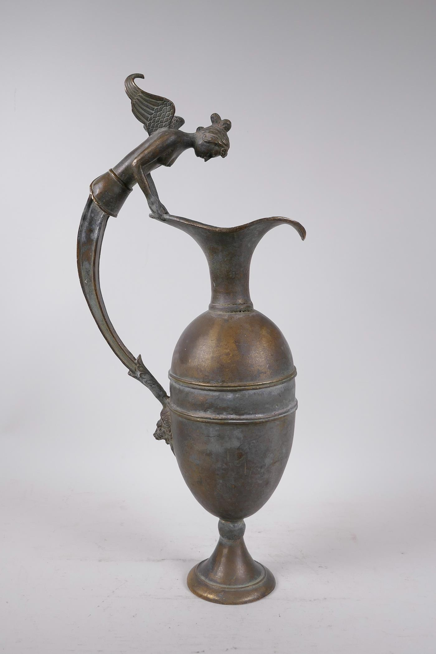 """A Greco-Roman style bronze urn, the handle decorated with the bust of a siren, 18½"""" high"""