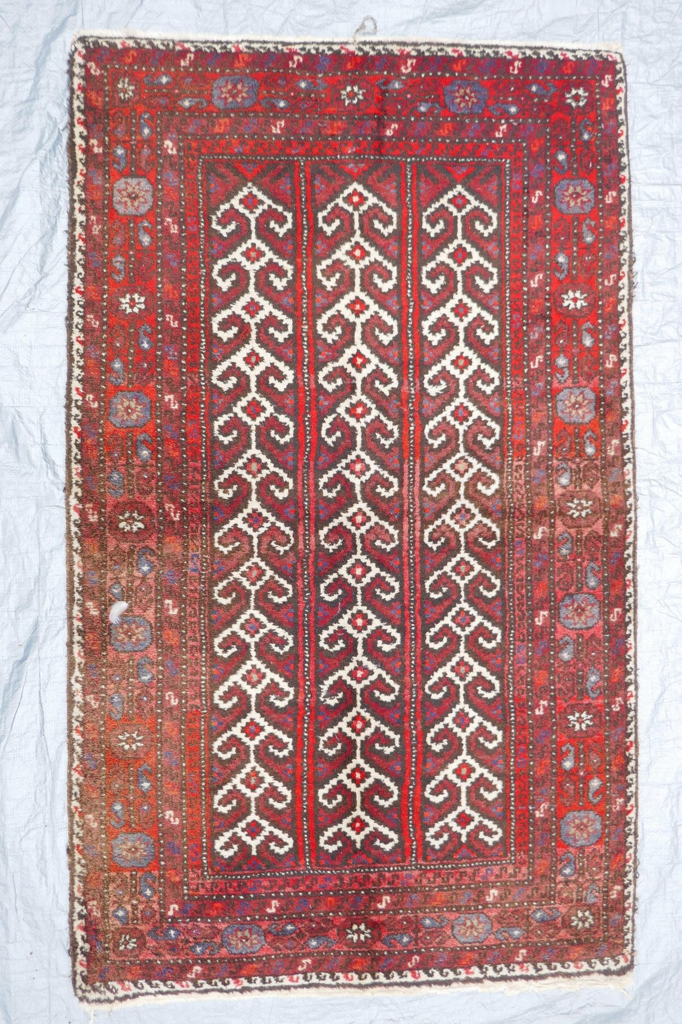 """A Middle Eastern full pile red ground wool rug with a three panel geometric design, 34"""" x 56"""" - Image 2 of 4"""