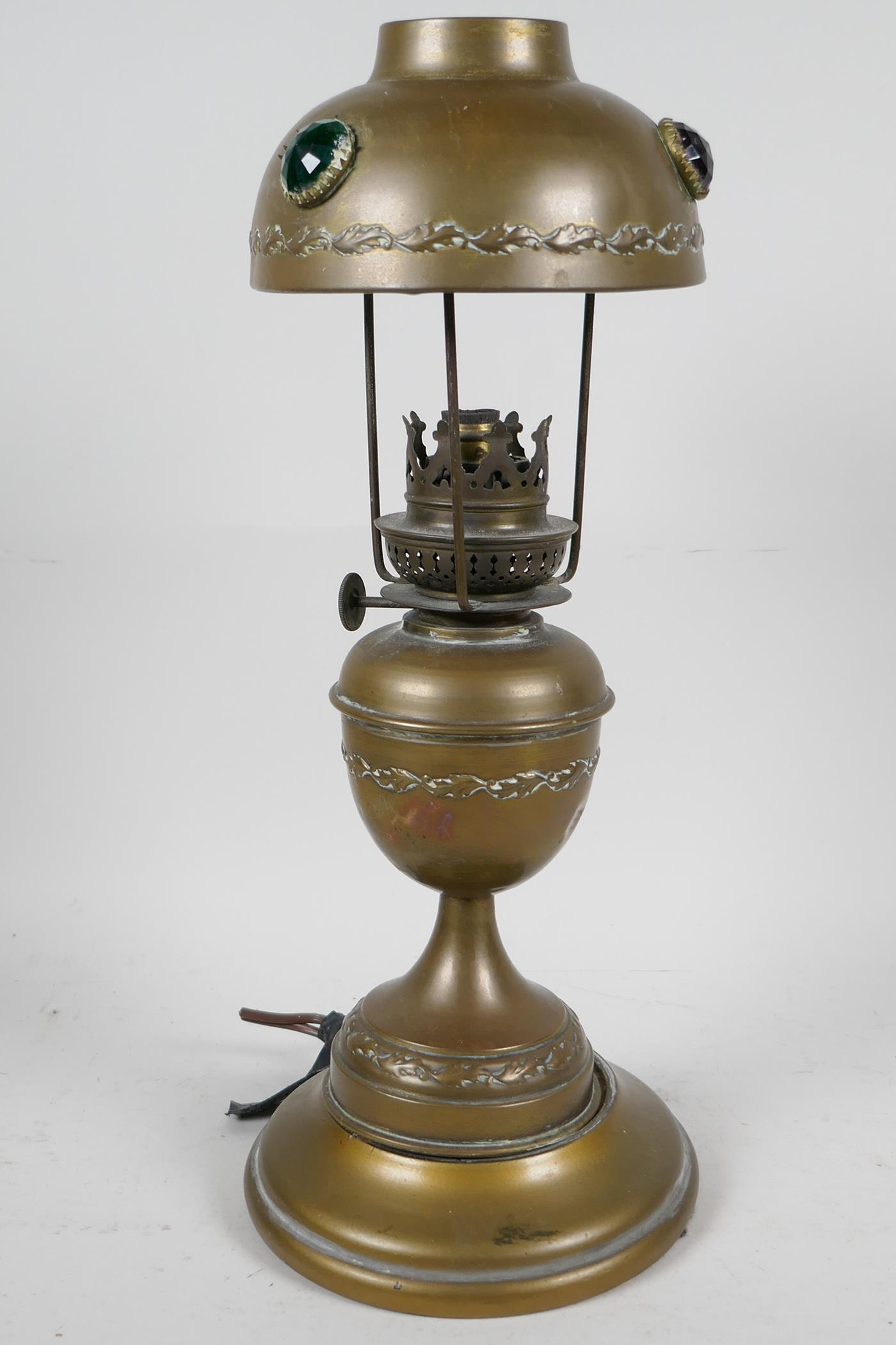 """A brass table lamp with brass shade set with coloured stones, 13"""" high"""
