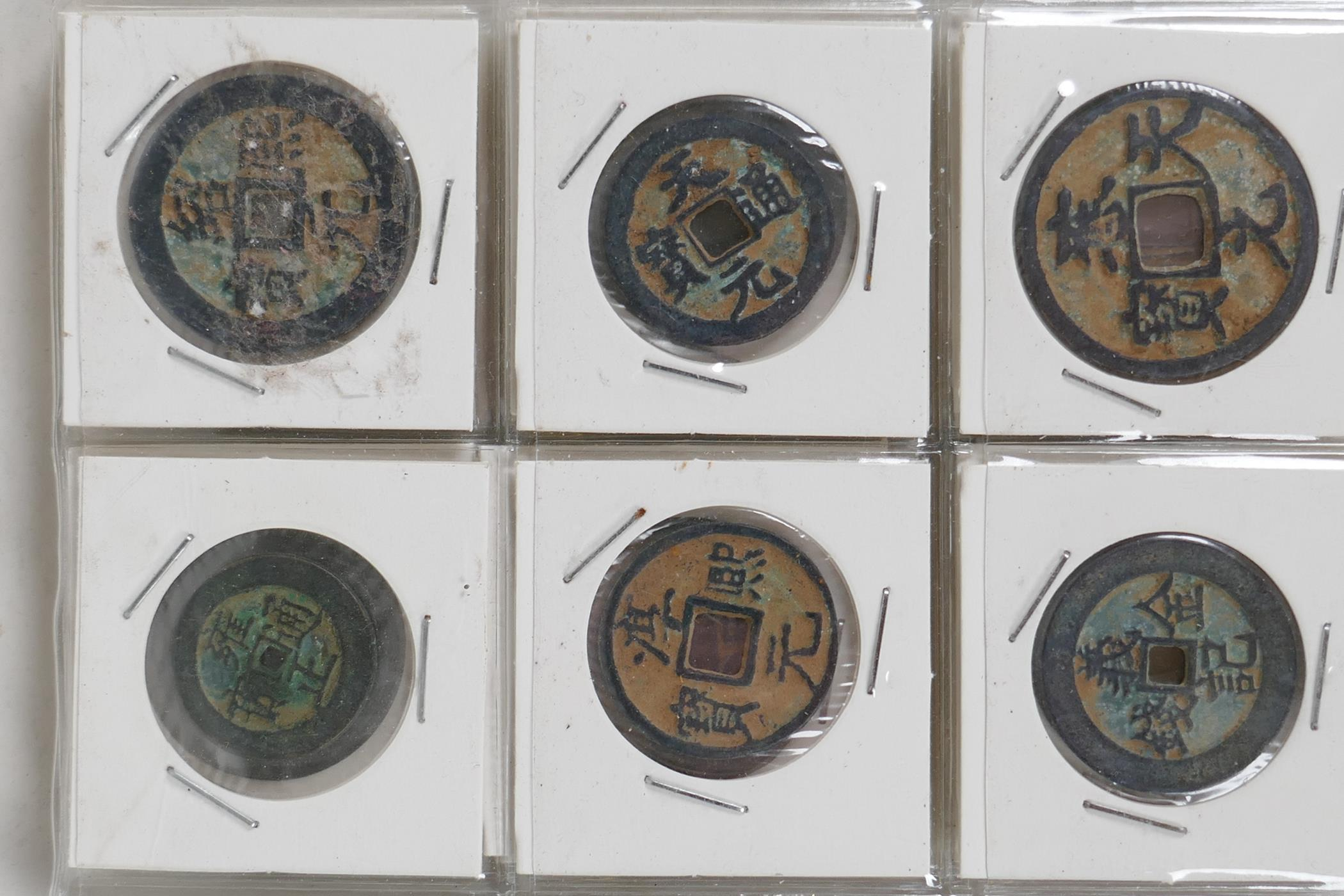 A small album containing 30 replica Chinese coins