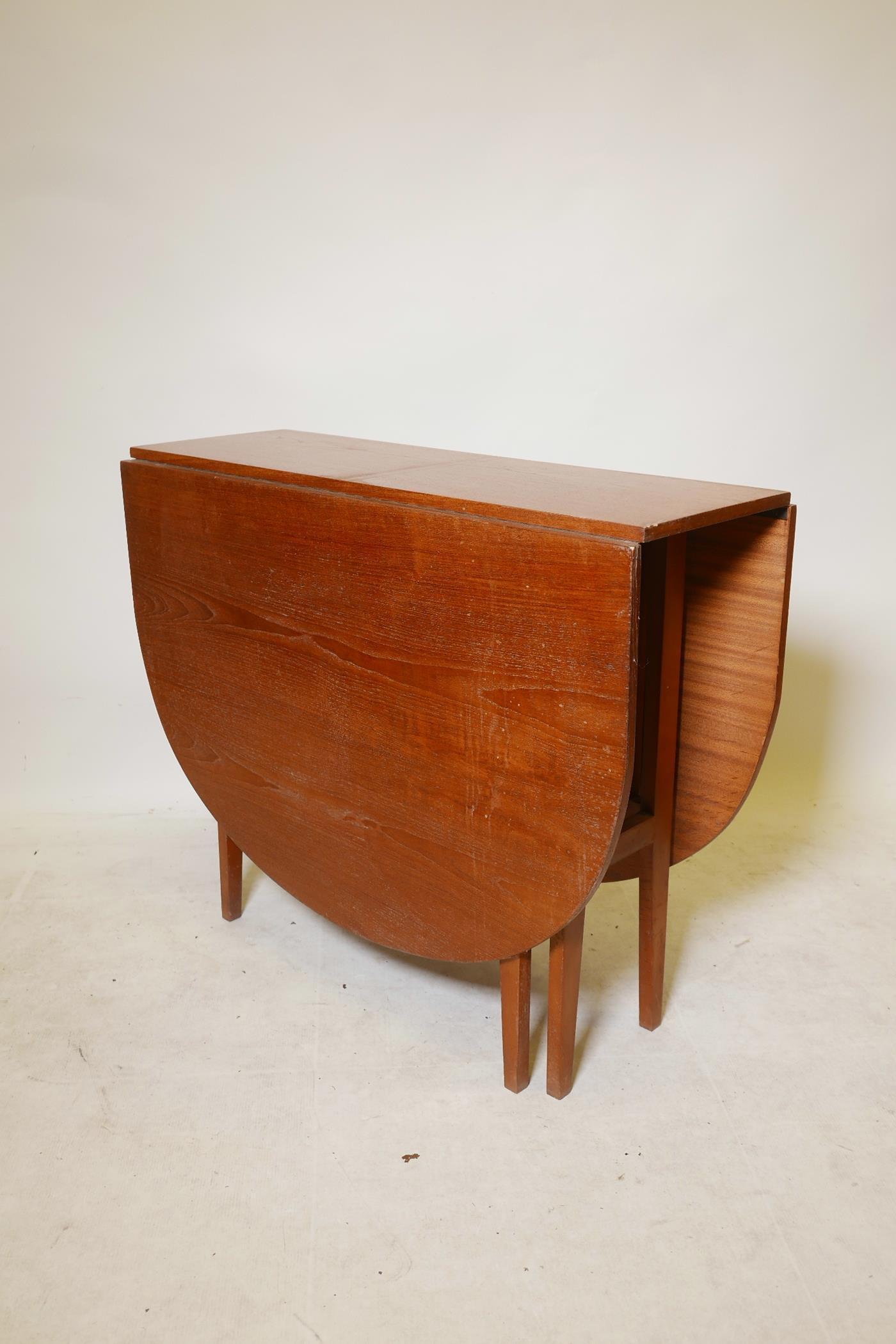 "A 1970s teak gateleg table, 59"" x 35½"", 29"" high extended"
