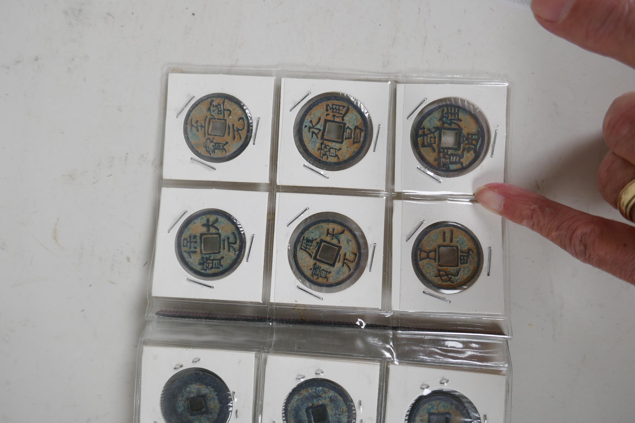 A small album containing 30 replica Chinese coins - Image 5 of 6