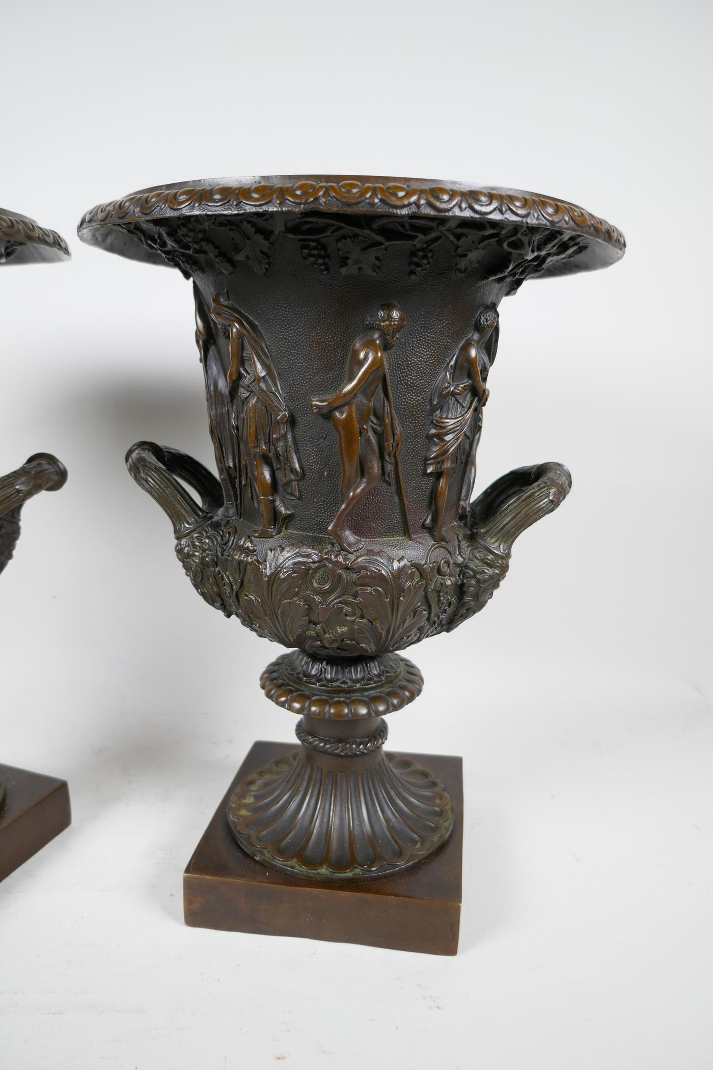 A pair of classical Grand Tour style bronze pedestal urns decorated with many figures on square - Image 2 of 4