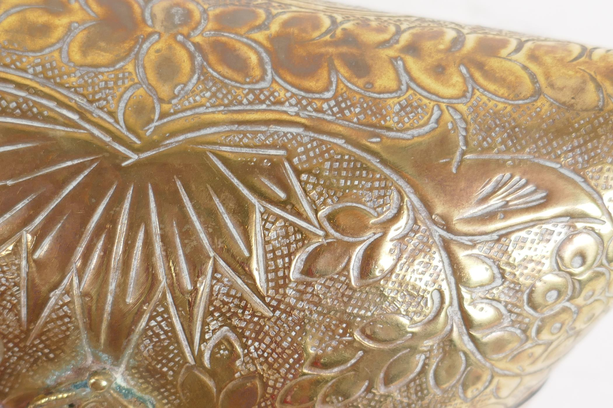 An Indian brass cushion shaped shoulder purse with engraved floral decoration, coppered bands and - Image 3 of 4