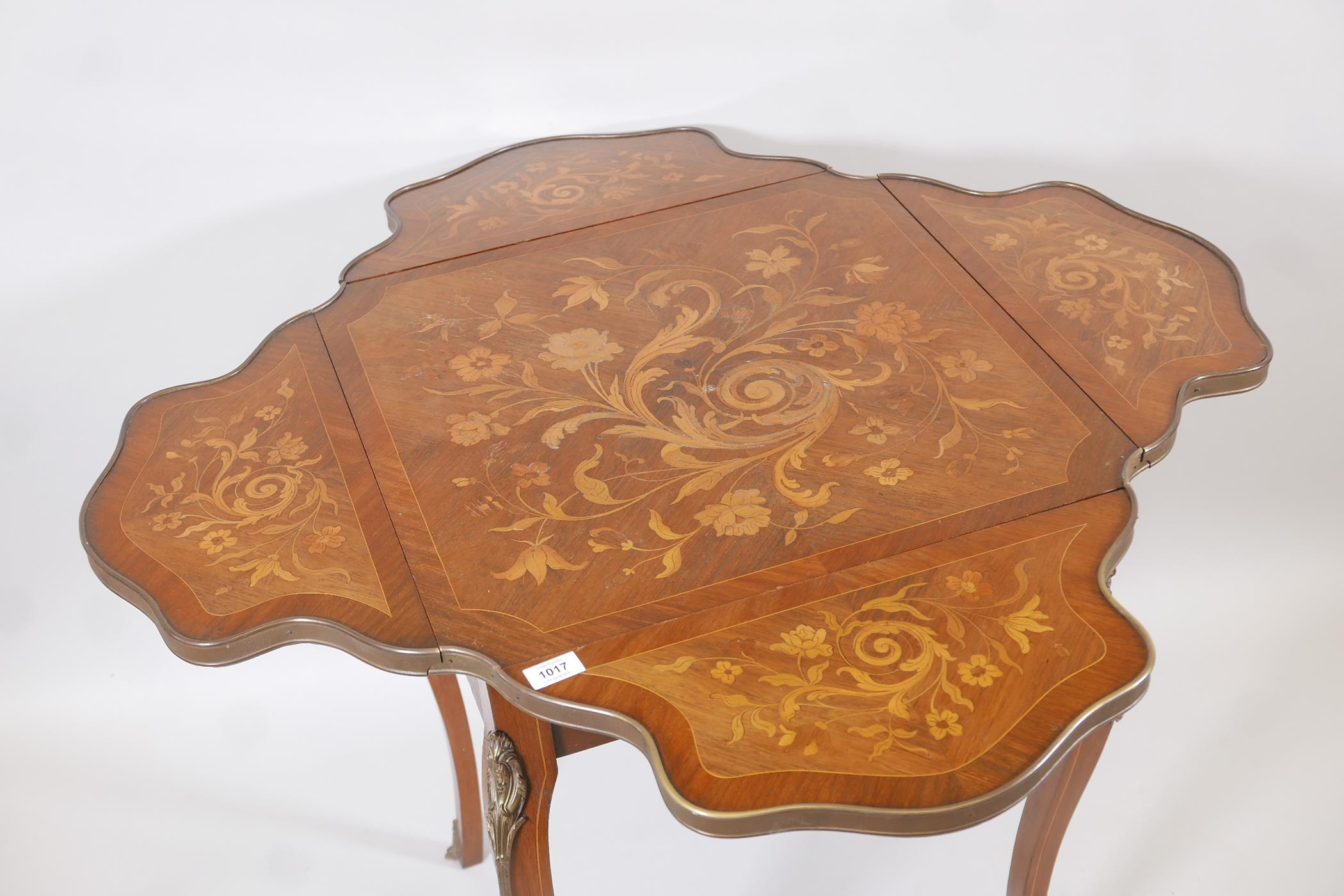 A French C19th marquetry inlaid rosewood centre table, with shaped drop leaves and gilt brass - Image 4 of 5