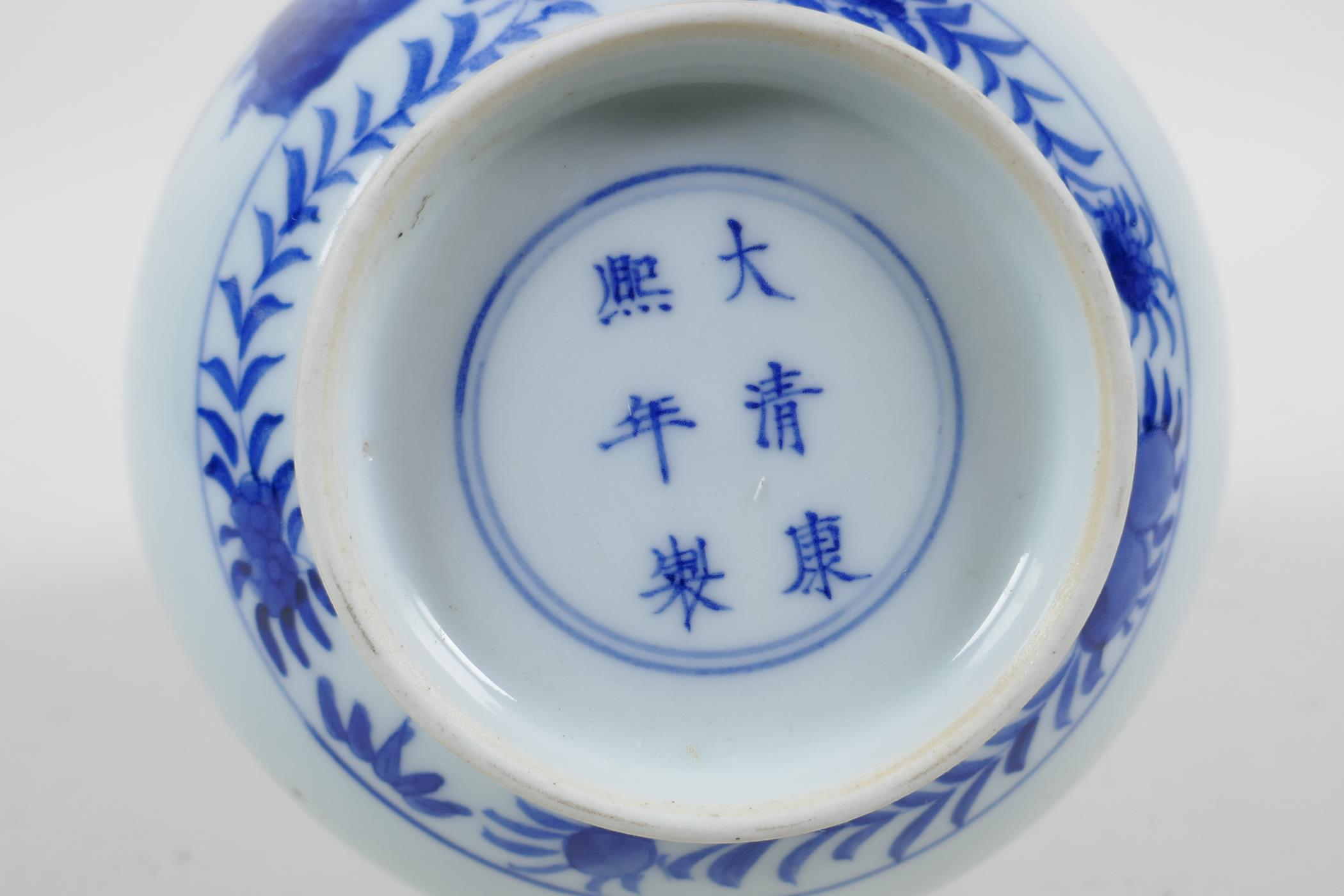 A Chinese blue and white porcelain bottle vase decorated with travellers in a landscape, 6 character - Image 5 of 5