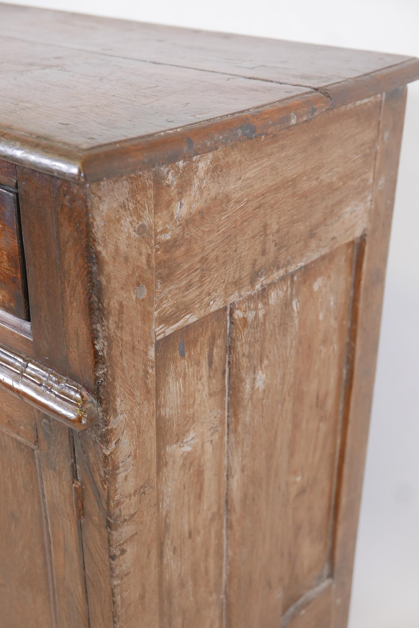 An antique oak side cabinet, with panelled ends and cupboards under three drawers, C18th and later - Image 5 of 5