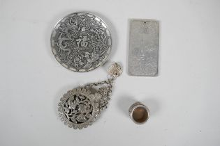 A collection of four Chinese white metal items to include a trinket dish with dragon decoration,