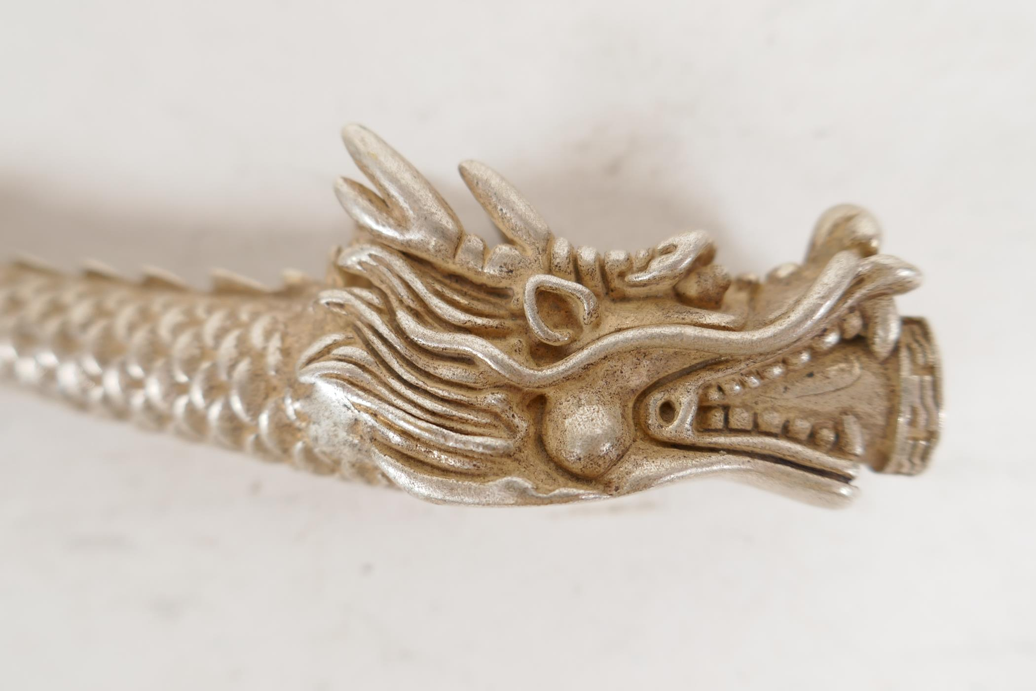 """A Chinese white metal cheroot holder cast in the form of a dragon, character mark to base, 4"""" long - Image 2 of 5"""