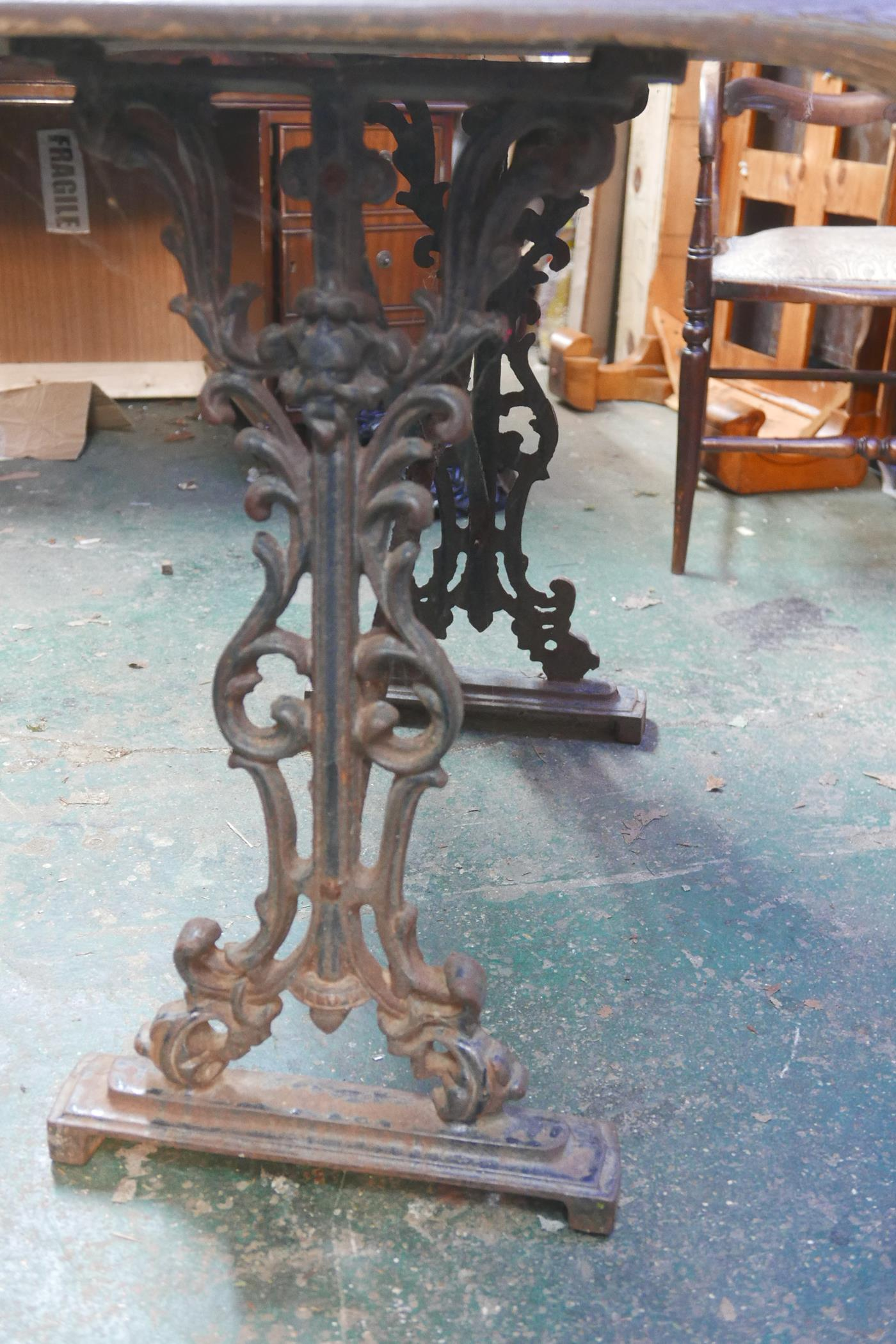 """A garden table with cast iron base, A/F, 28½"""" high x 36"""" x 24"""" - Image 3 of 3"""