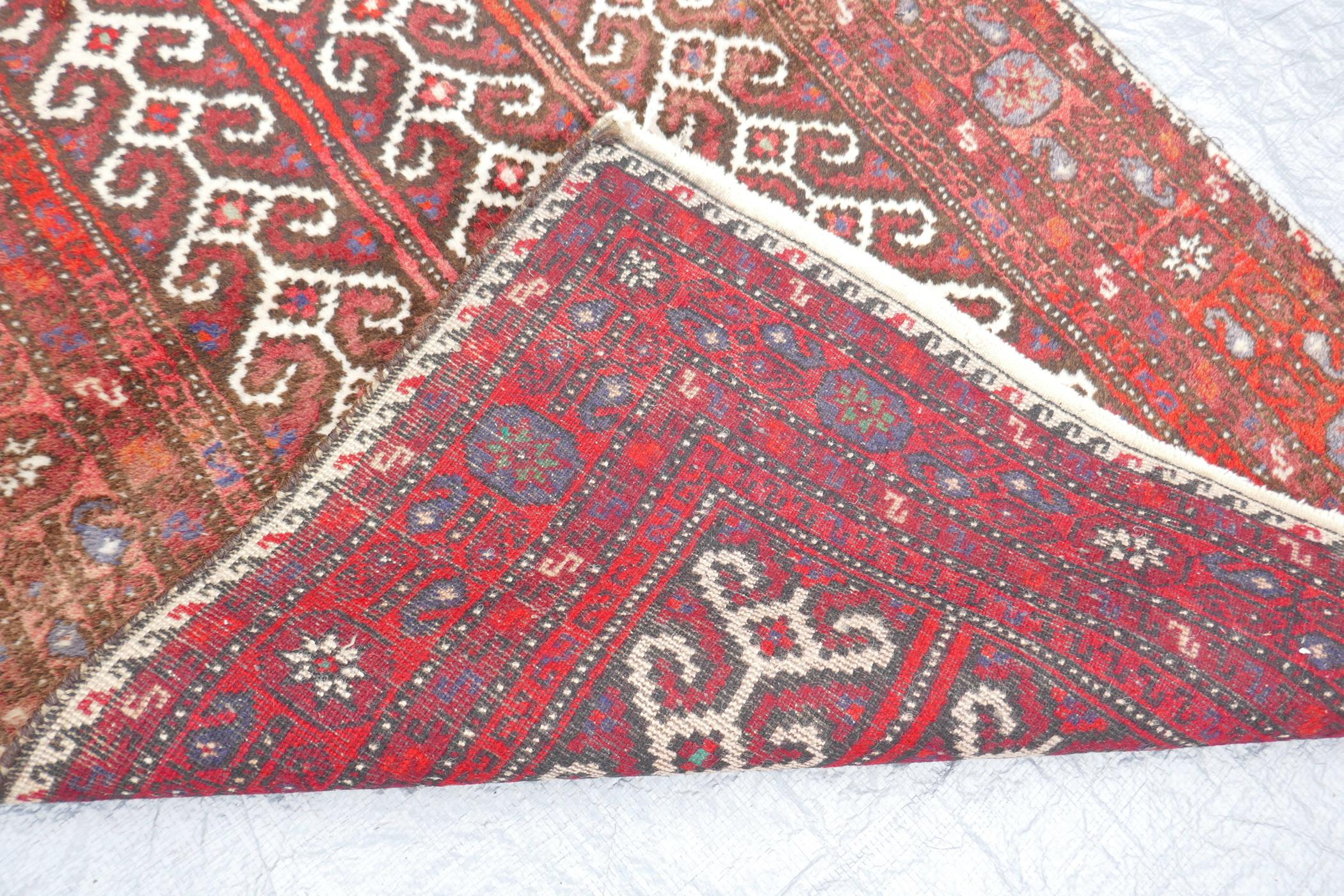 """A Middle Eastern full pile red ground wool rug with a three panel geometric design, 34"""" x 56"""" - Image 4 of 4"""