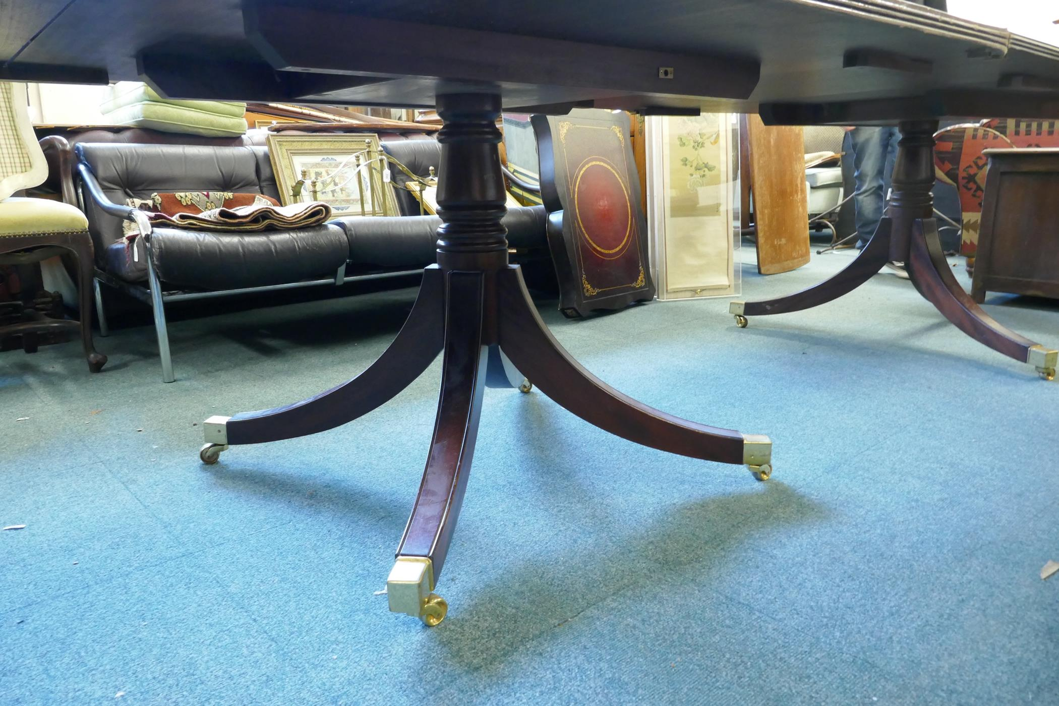 A Regency style three pillar dining table with mahogany veneered top and reeded edge, raised on - Image 7 of 7