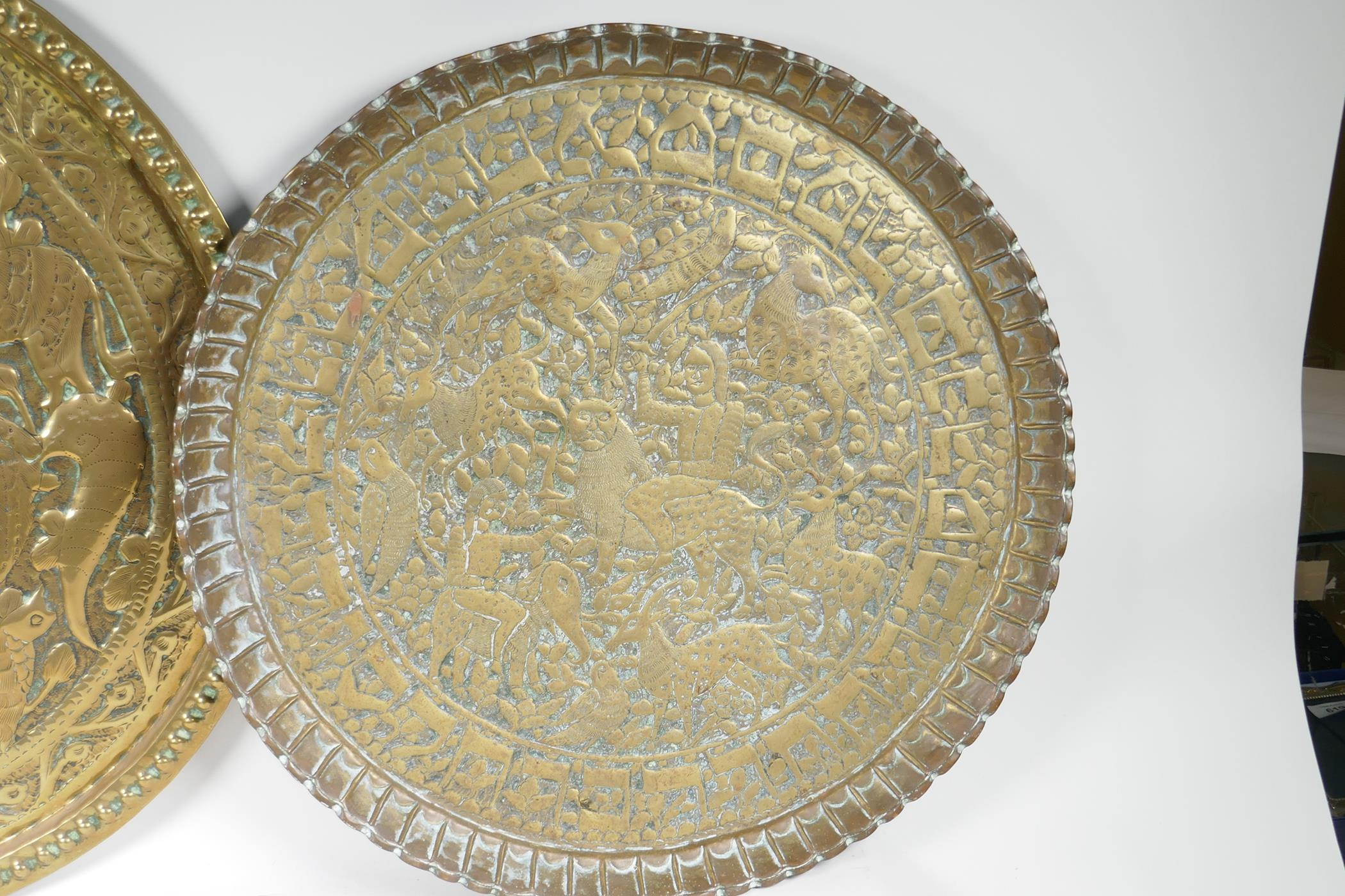 """A Persian brass charger embossed with a figure on horseback surrounded by animals and birds, 24"""" - Image 3 of 4"""