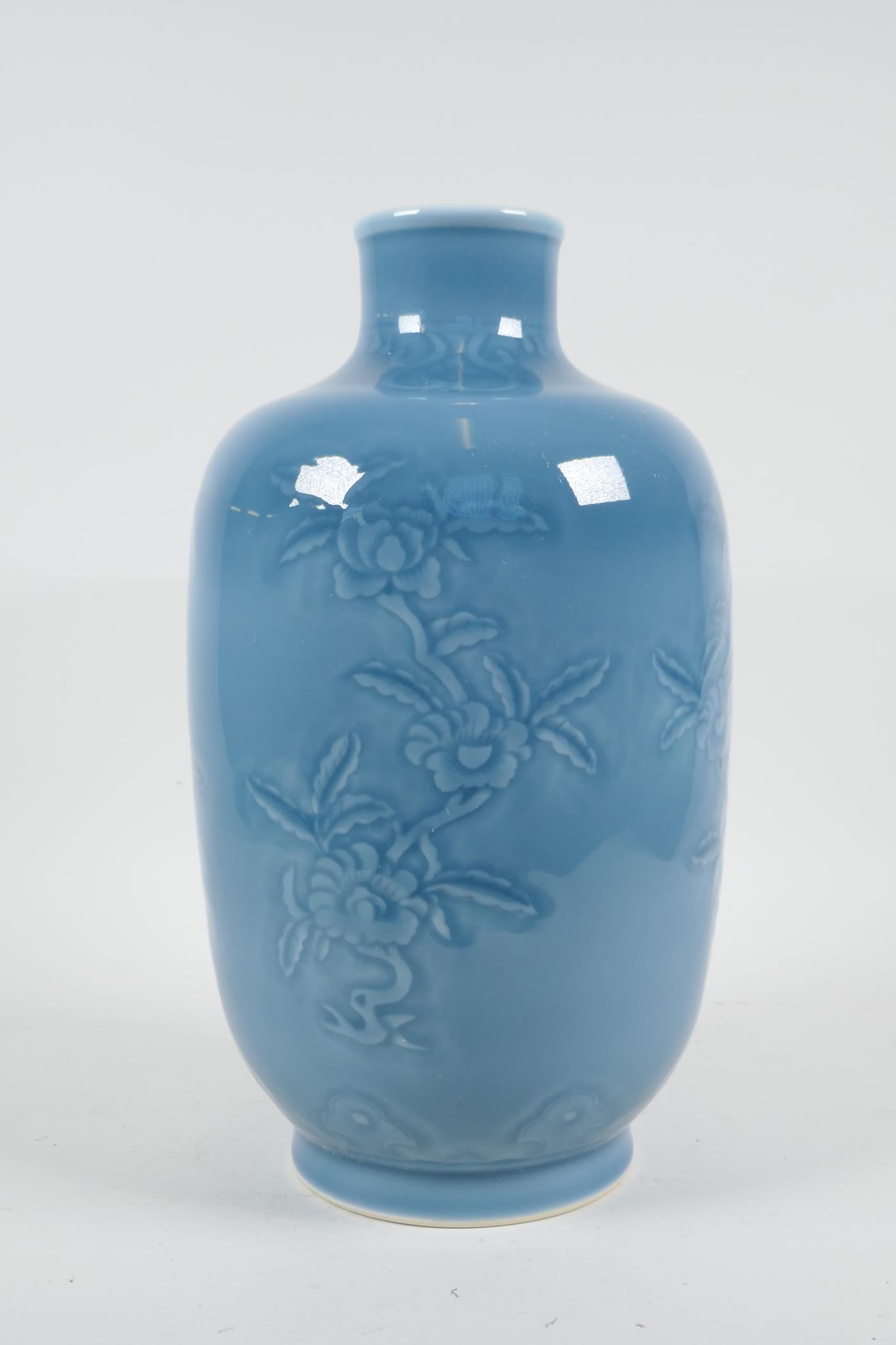 "A Chinese blue glazed porcelain vase with underglaze floral decoration, seal mark to base, 11"" high"