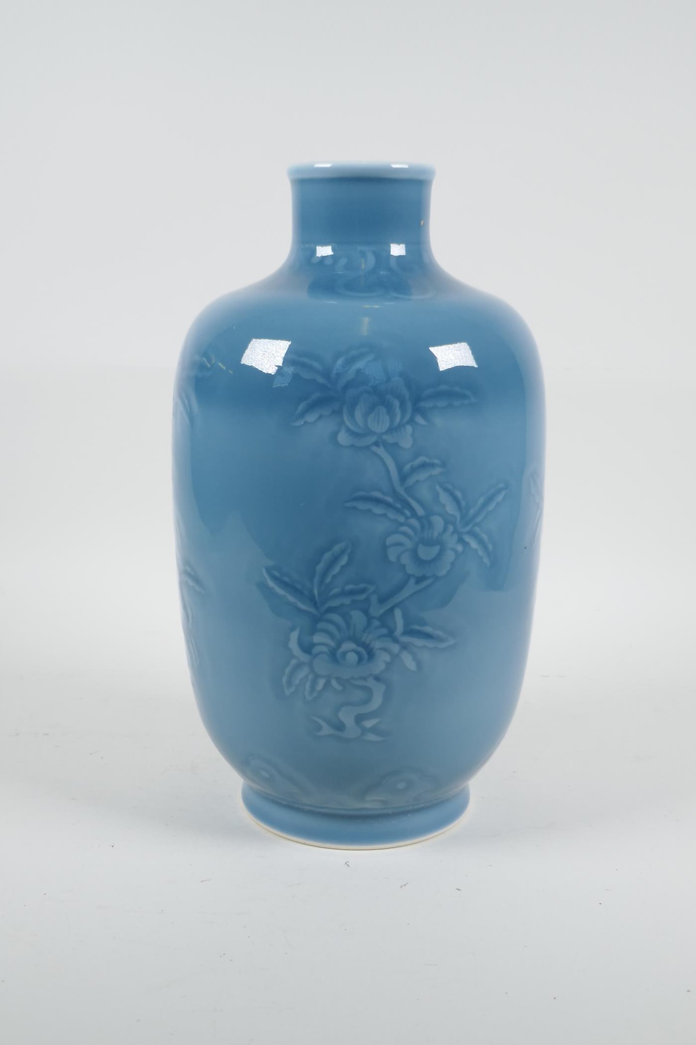 "A Chinese blue glazed porcelain vase with underglaze floral decoration, seal mark to base, 11"" high - Image 3 of 4"