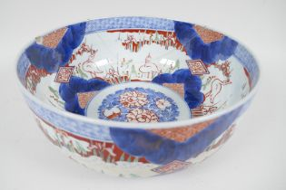 A C19th Japanese Imari porcelain bowl painted with herons amongst the reeds, in traditional colours,
