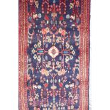 """A rich blue ground full pile Persian Sarouk runner with an unique floral pattern, 122"""" x 41"""""""