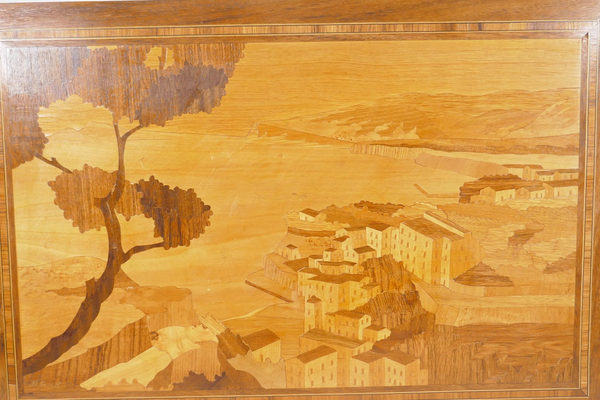 """A Sorrento wood panel with inlaid decoration of an Italian cliffside village, 23½"""" x 16"""""""