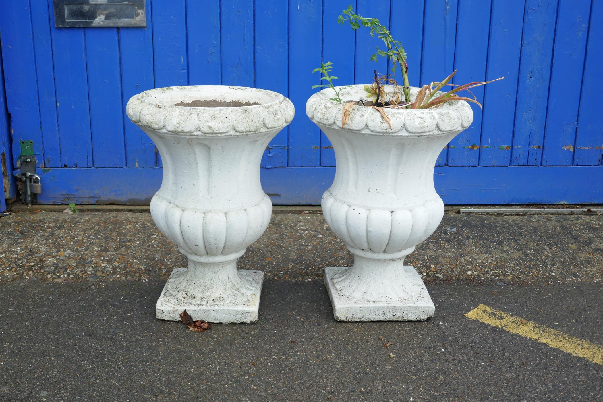 "A pair of painted concrete garden urns, 22½"" high, 16½"" diameter"