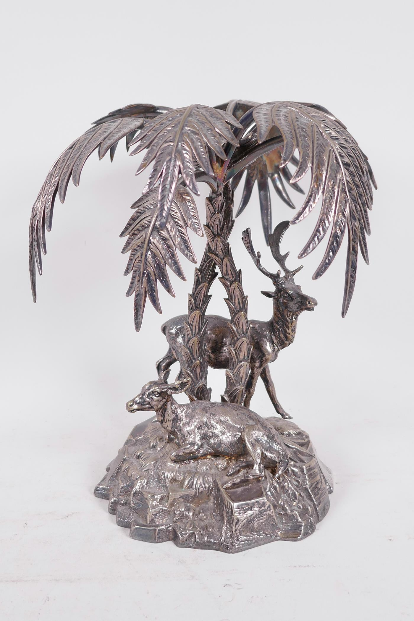 A C19th silver plated table centrepiece formed as deer under a palm tree by Thomas Bradbury and