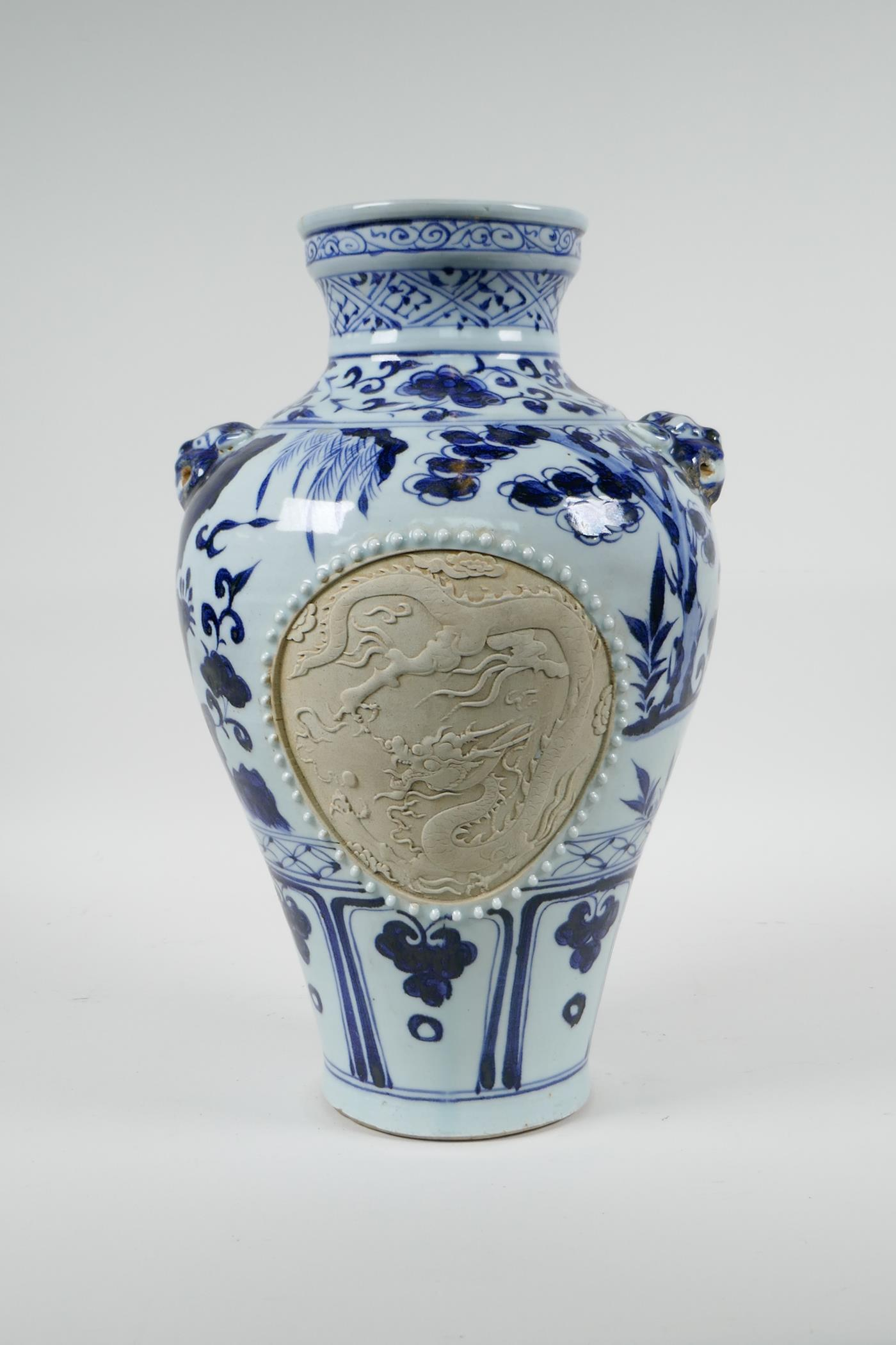 A Chinese blue and white porcelain vase with two lion mask handles, chased decorative panels - Image 4 of 8