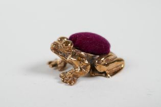 A miniature coppered metal pincushion in the form of a frog