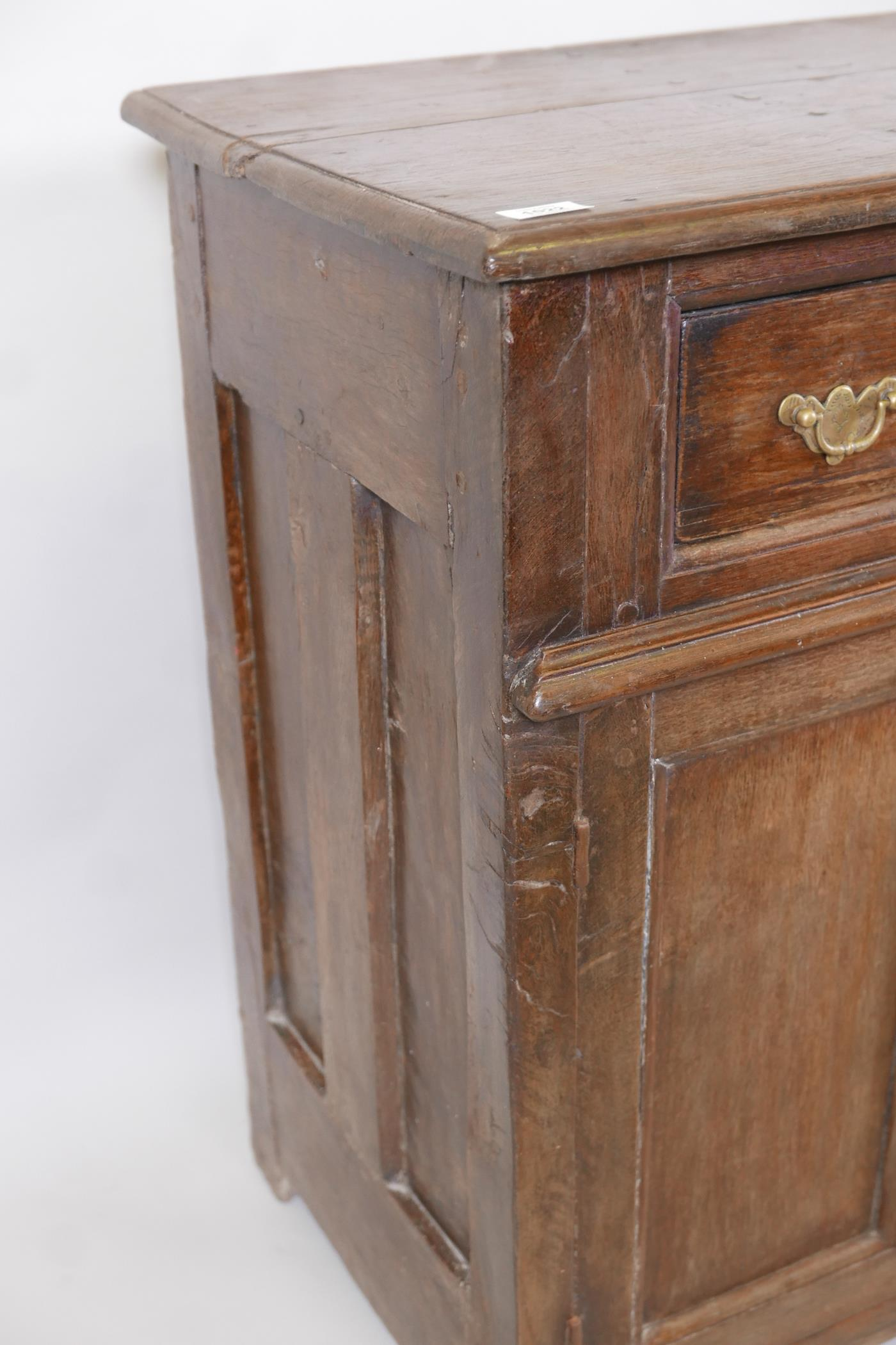 An antique oak side cabinet, with panelled ends and cupboards under three drawers, C18th and later - Image 4 of 5