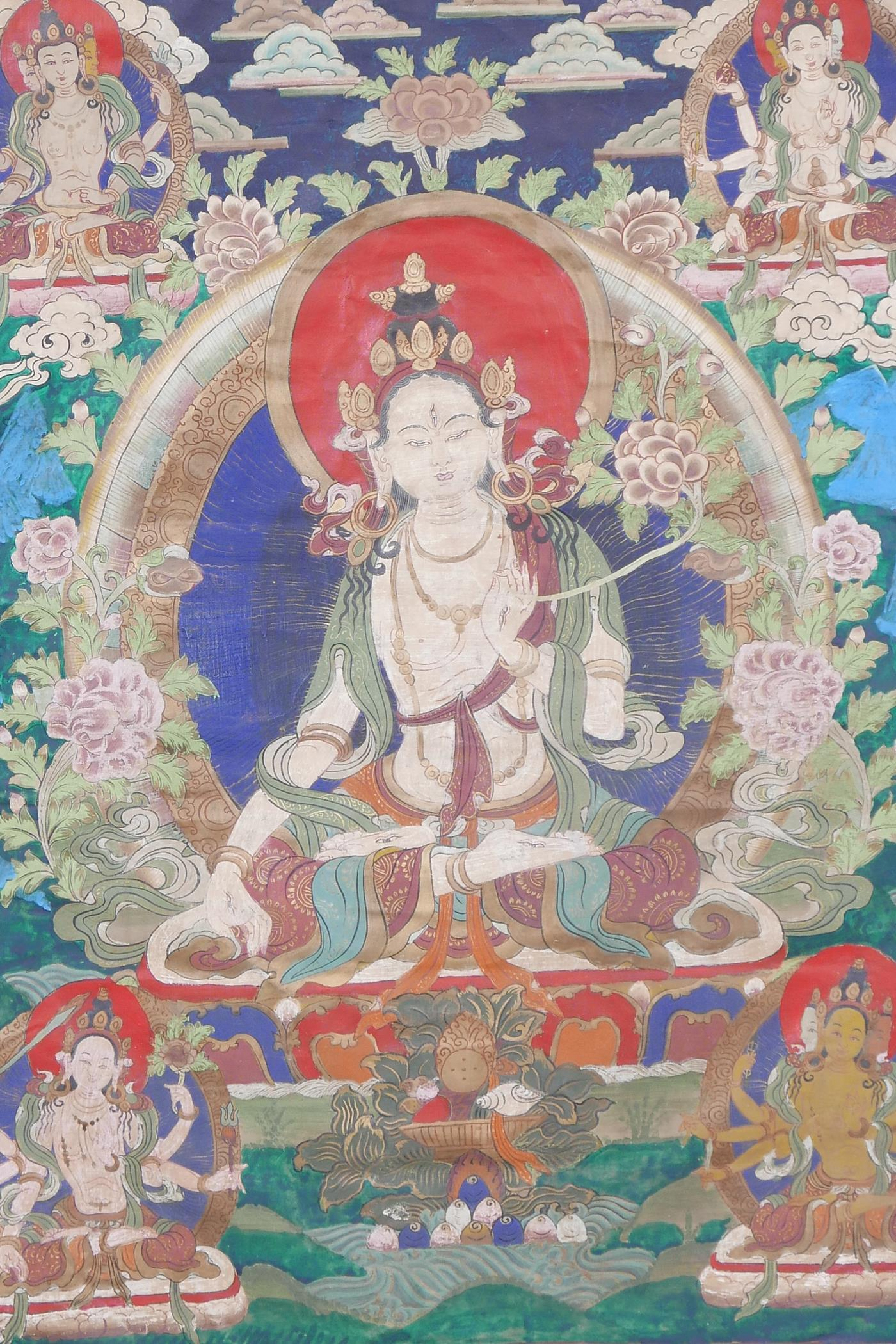 A Sino-Tibetan printed thangka depicting various facets of Buddha, with hand painted embellishments,