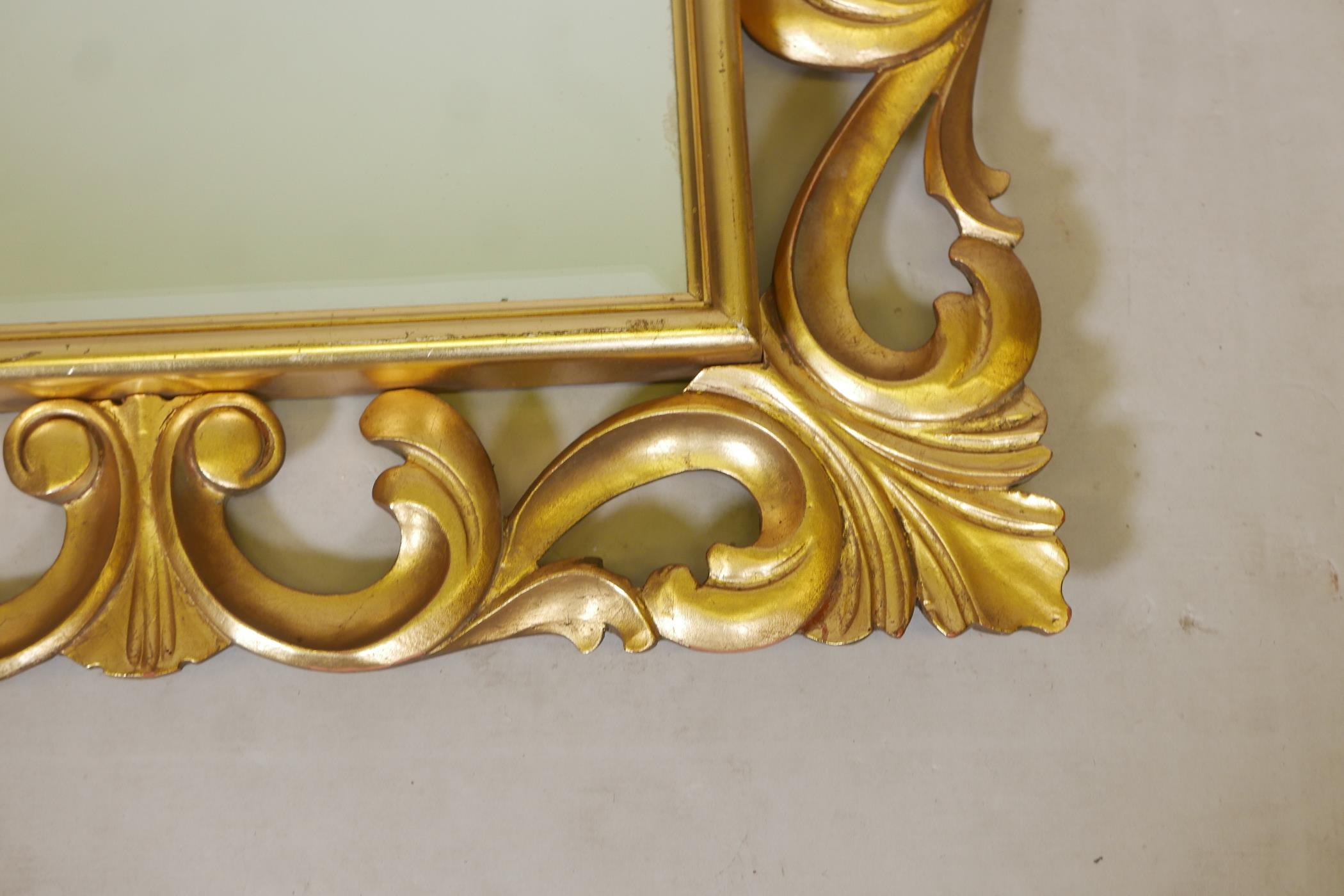 """A carved giltwood Florentine style wall mirror with bevelled glass, mid C20th, 25"""" x 30"""" - Image 2 of 2"""