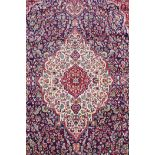 """A rich blue ground full pile Kashan rug with a traditional floral medallion pattern, 94"""" x 63"""""""