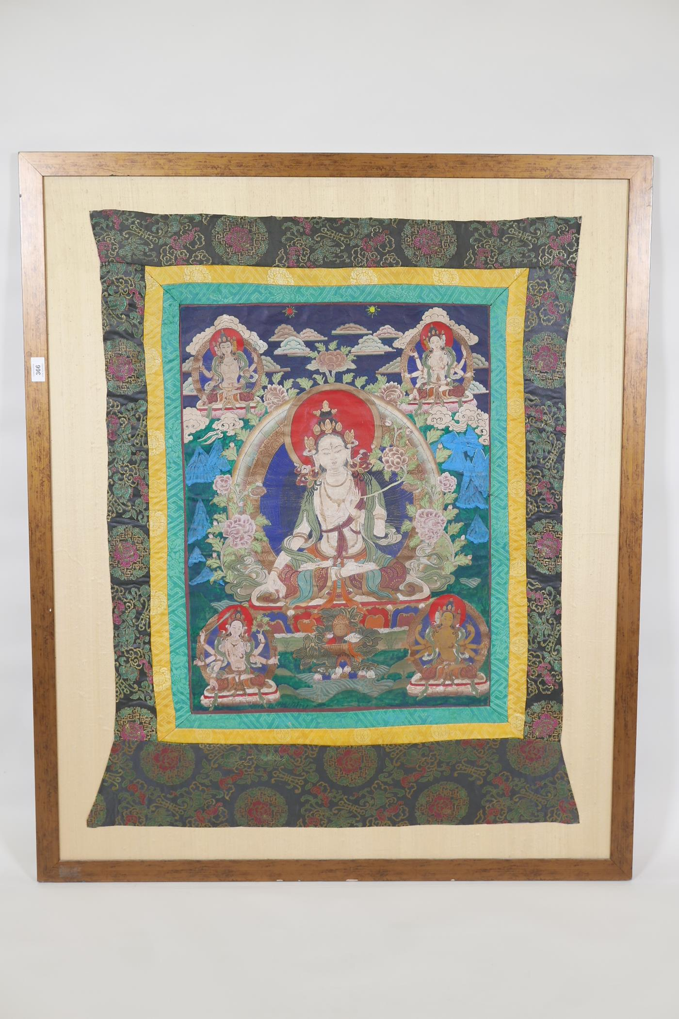 A Sino-Tibetan printed thangka depicting various facets of Buddha, with hand painted embellishments, - Image 2 of 2