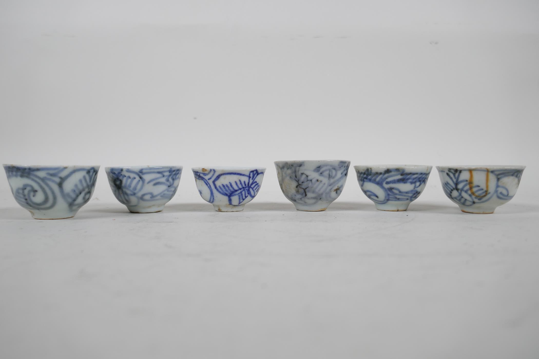 """Six Chinese antique blue and white wine/tea cups, 1½"""" diameter"""