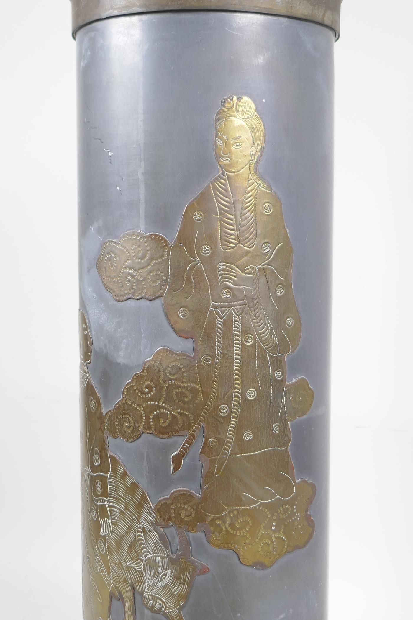 """A pewter and brass cylinder lamp with Chinese decoration depicting figures and a buffalo, 21"""" high - Image 3 of 3"""
