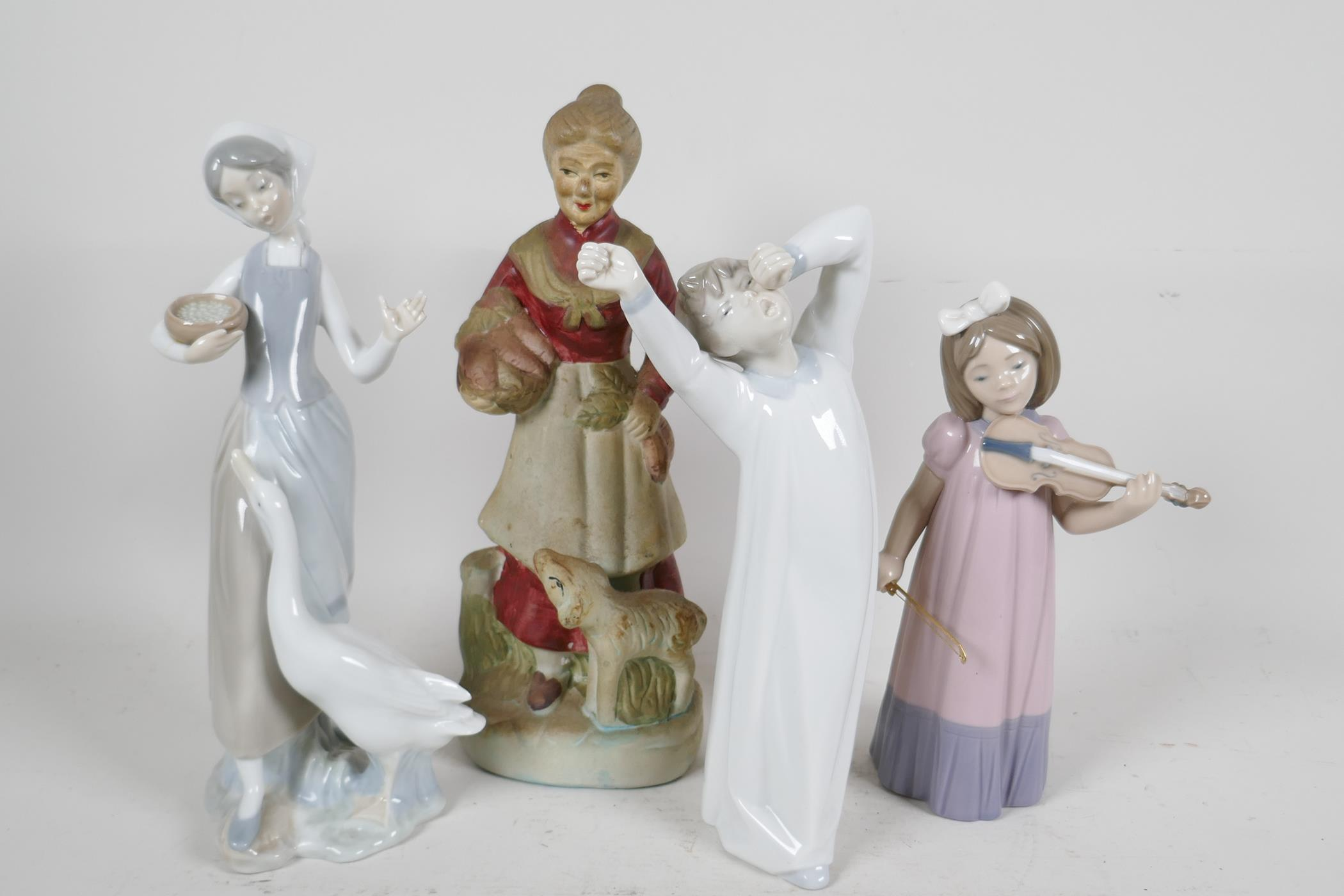 Two Lladro figures, sleepy boy and woman with geese (missing finger), a Nao Daisia figure of a