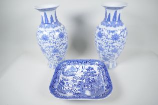 """A pair of Chinese blue and white vases decorated with stylised flowers, 12"""" high, together with a"""