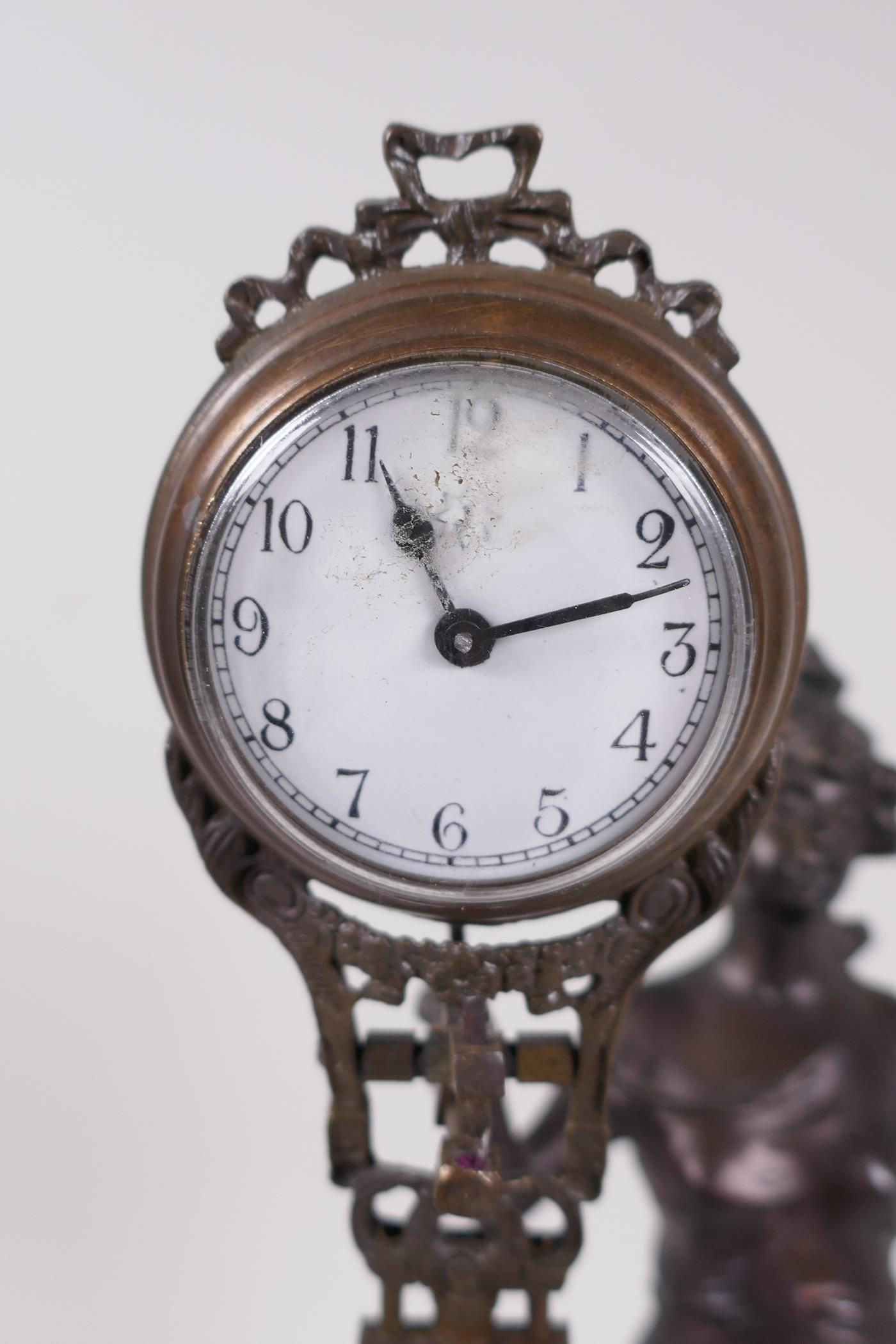 """A bronze mystery clock cast as an Art Nouveau style lady with the clock raised on one arm, 13"""" high - Image 3 of 4"""