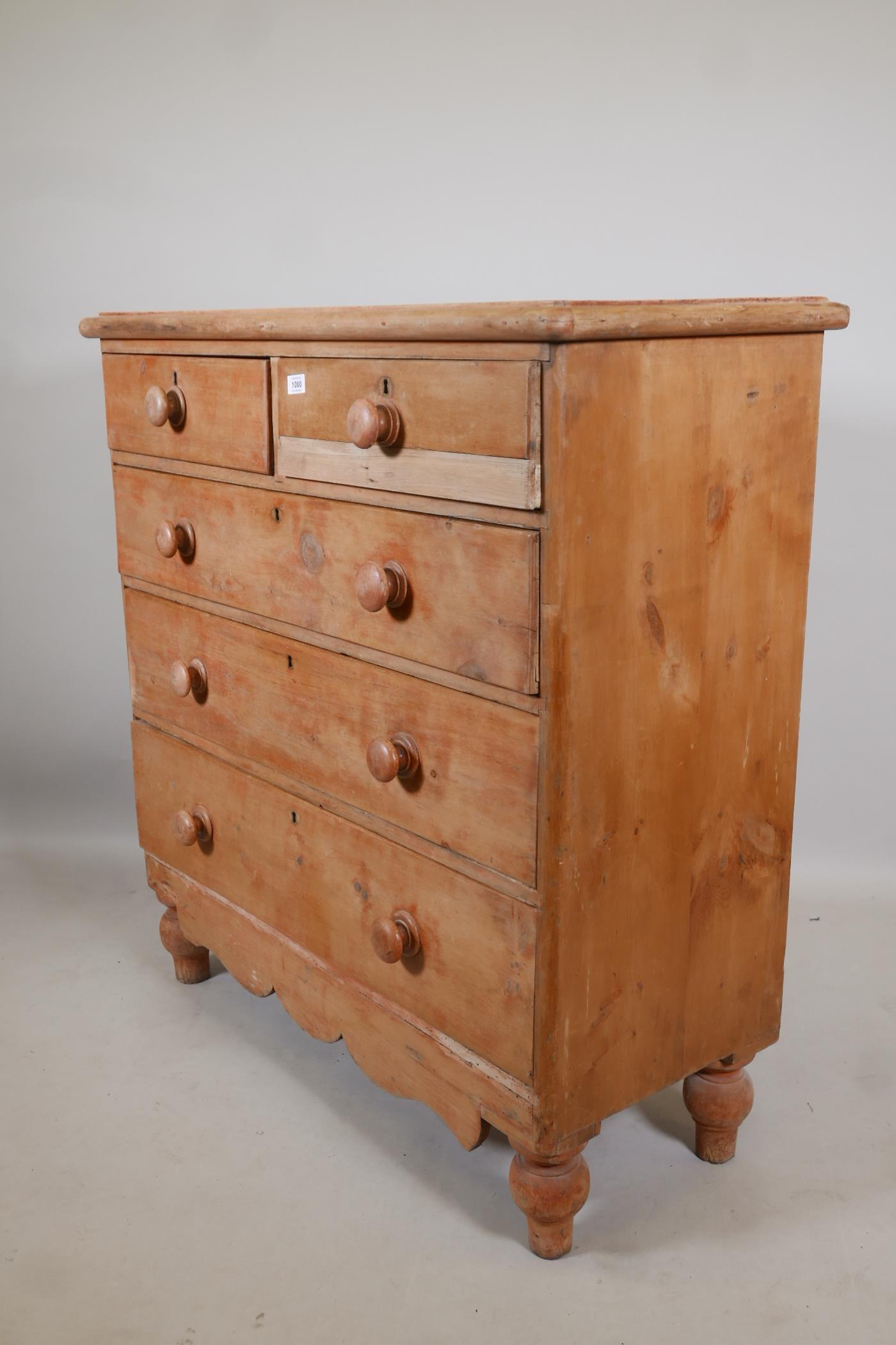 A Victorian stripped pine chest of two over three drawers, with wood handles and shaped apron, - Image 2 of 2