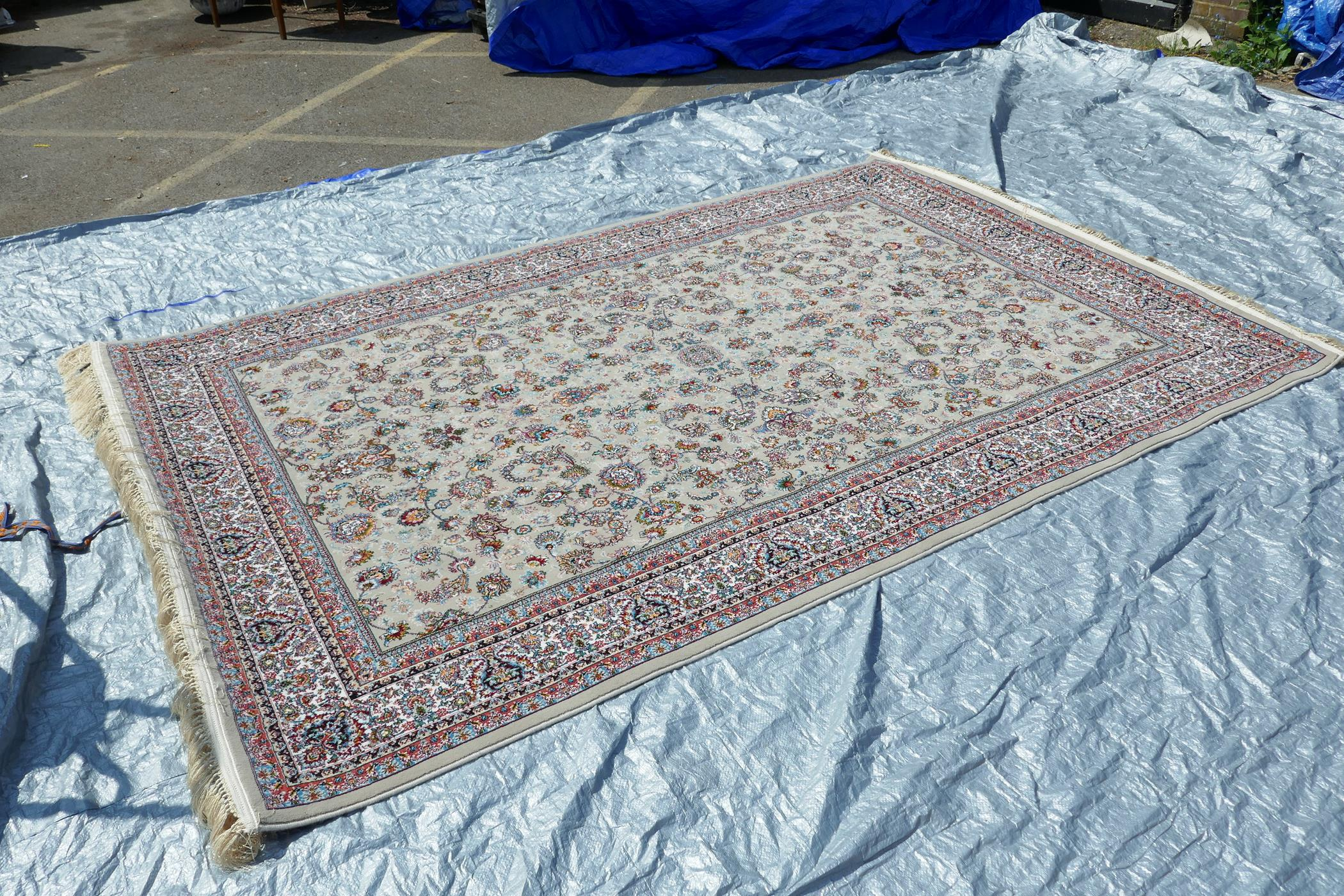 """A fine woven beige ground full pile Iranian carpet with an all over floral pattern, 118"""" x 78"""" - Image 3 of 5"""