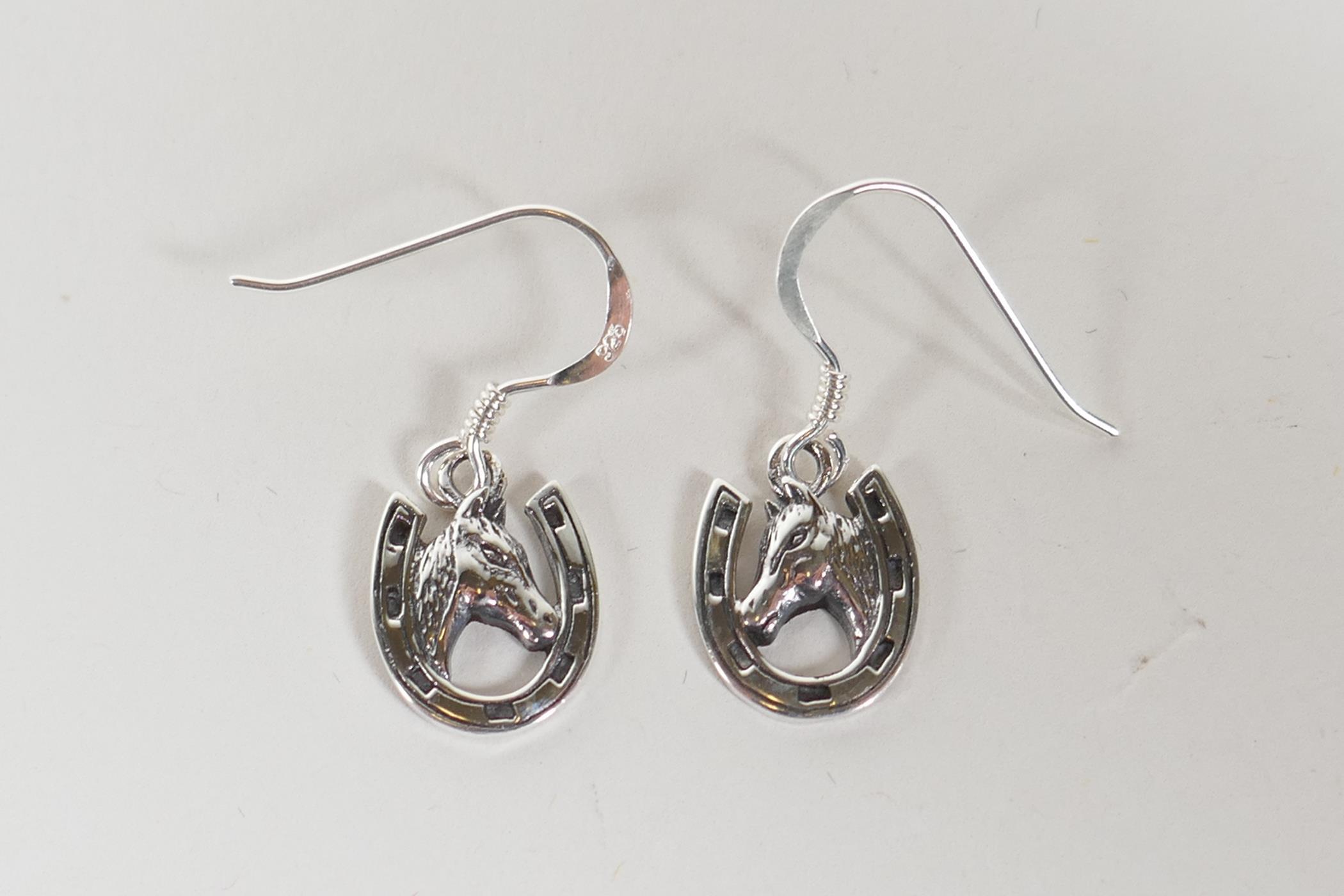 A pair of 925 silver horseshoe drop earrings