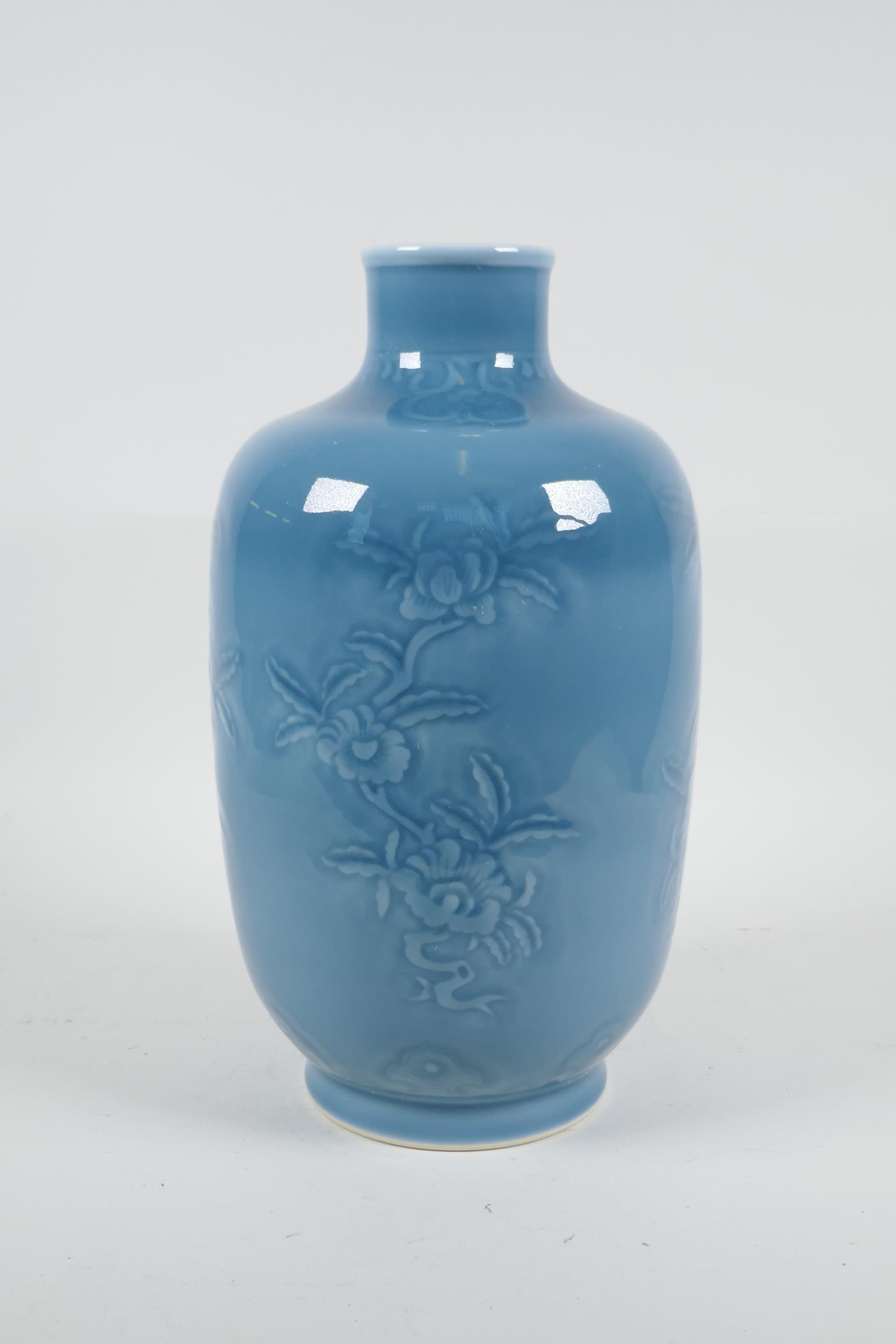 "A Chinese blue glazed porcelain vase with underglaze floral decoration, seal mark to base, 11"" high - Image 2 of 4"