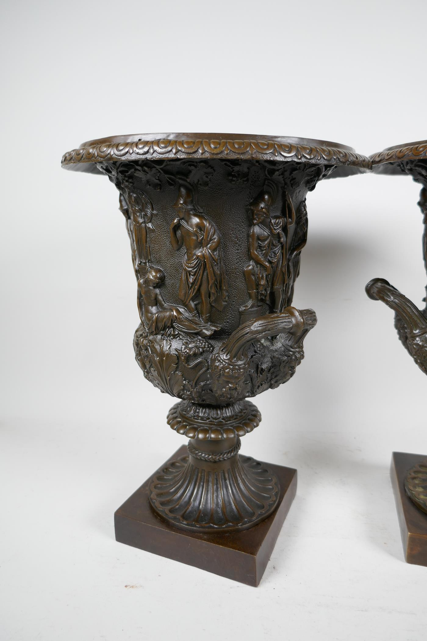 A pair of classical Grand Tour style bronze pedestal urns decorated with many figures on square - Image 3 of 4