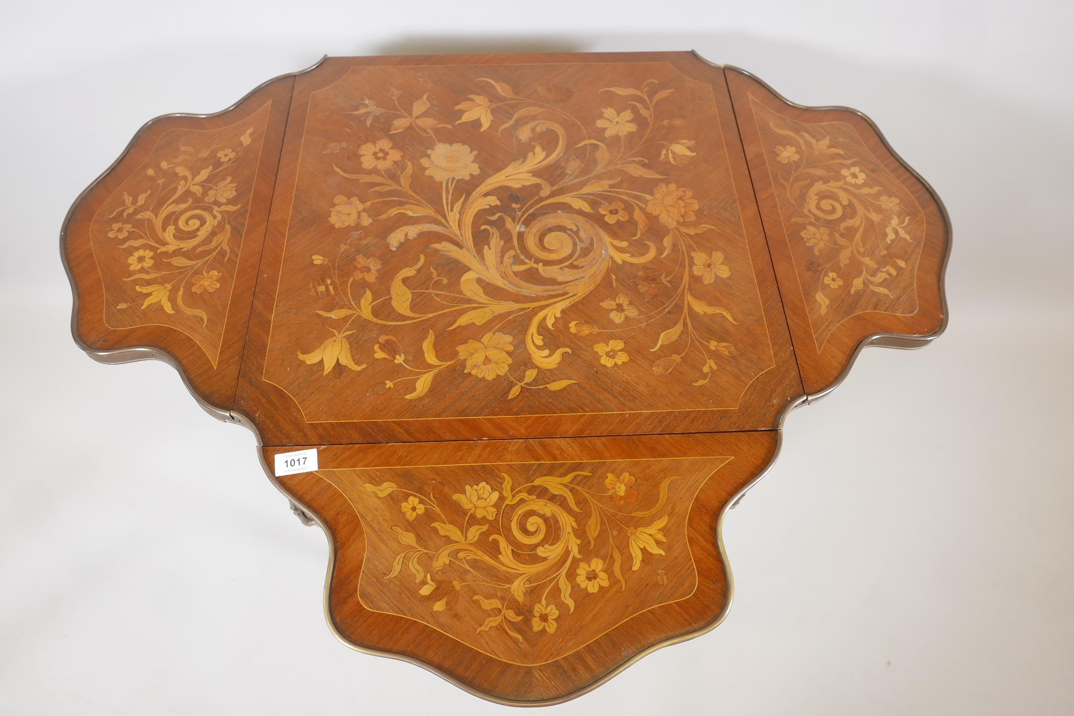 A French C19th marquetry inlaid rosewood centre table, with shaped drop leaves and gilt brass - Image 5 of 5