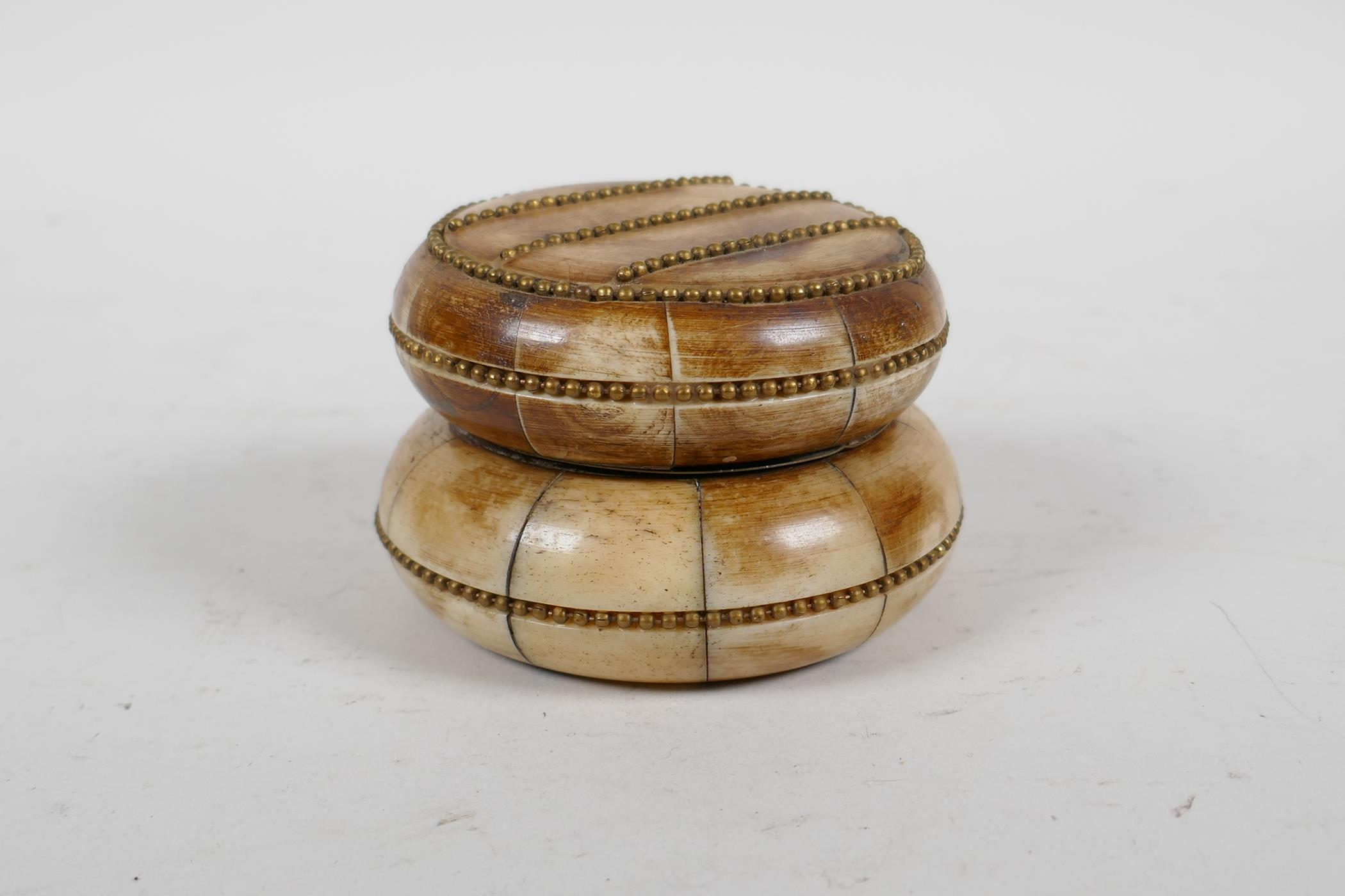 """A sectional bone box and cover with brass beaded details, 3"""" diameter"""